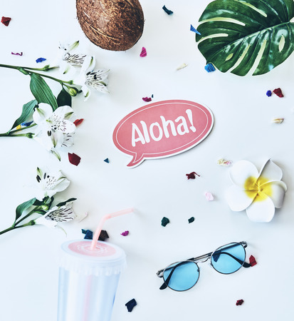 Hello summer! High angle shot of eyewear, coconut and flower lying against white background