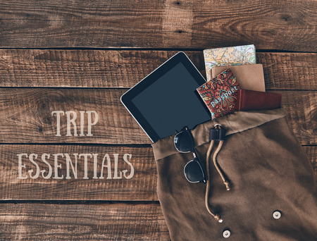 Trip essentials. High angle shot of bag with travel items Stock Photo