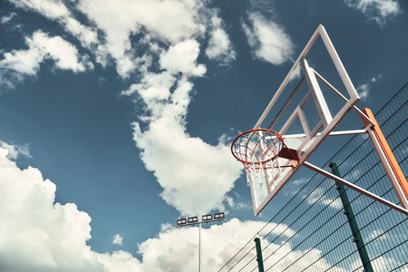 Basketball outdoors. Shot of basketball hoop with sky in the background outdoors