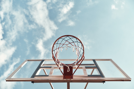 Outdoors fun. Shot of basketball hoop with sky in the background outdoors