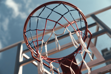 Best game ever. Shot of basketball hoop with sky in the background outdoors