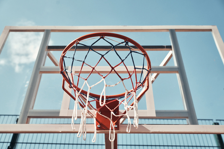 Are you ready to play? Shot of basketball hoop with sky in the background outdoors