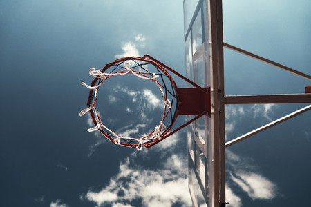 Basketball hoop. Shot of basketball hoop with sky in the background outdoors