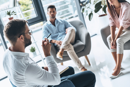 Be patient. Young married couple listening to psychologist while sitting on the therapy session Banque d'images - 106880823