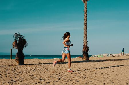 Towards a healthier lifestyle. Full length of beautiful young woman in sports clothing jogging while exercising outdoors