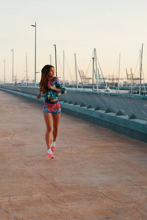 Never stop! Full length of beautiful young woman in sports clothing running while exercising outdoors 版權商用圖片