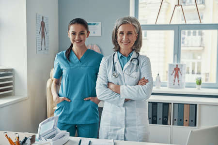 Two confident women coworkers in medical uniform
