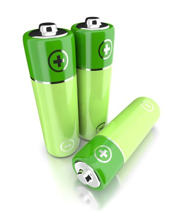 Three batteries of green color on a white background. Stock Photo