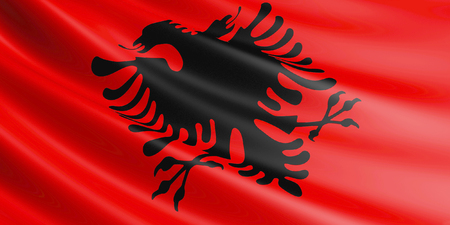 Albania flag fluttering in wind. Close-up, high resolution.