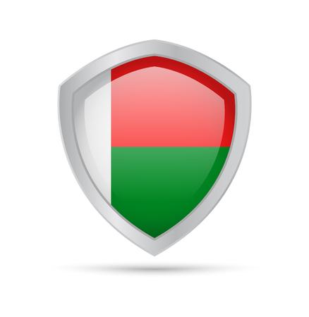 Bouclier avec le drapeau de Madagascar sur fond blanc. Illustration vectorielle.