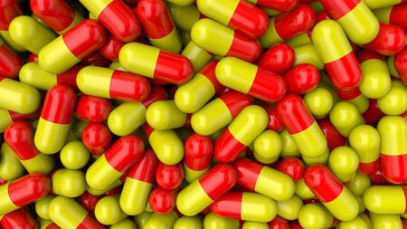 Colorful background pills. Red-yellow medical pills capsules