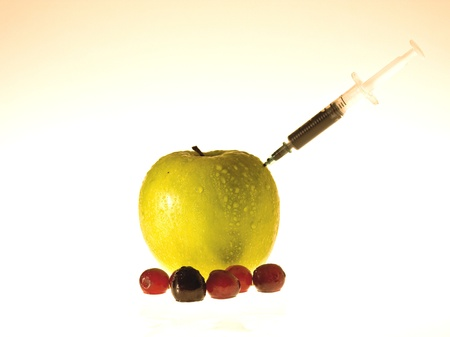 injector: Apple with an injector on it