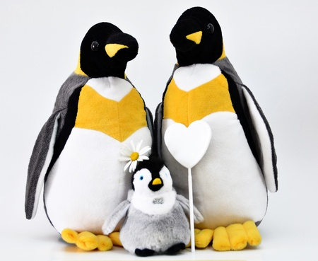 Toy penguins shot with heart shape. Stock Photo - 12193793