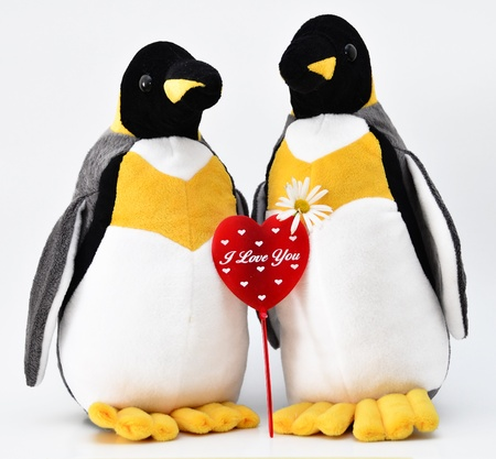 Toy penguins shot with heart shape. Stock Photo - 12193794