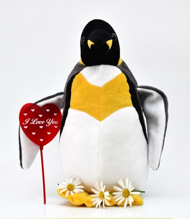 Toy penguin shot with heart shape. Stock Photo - 12193790