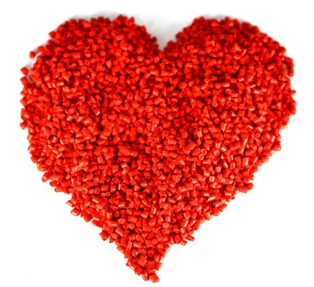 Heart shapes for Valentine�s Day and for lovers. Heart shaped plastic granules that are raw material for producing plastic items.  Stock Photo