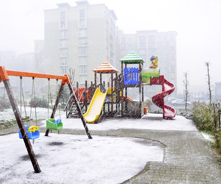 children's playground covered by snow. Stock Photo - 12193822
