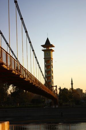 Old clock tower near the river in Adana, Turkey  Stock Photo
