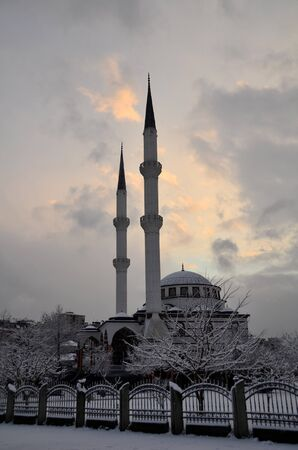 Sky was dark and it snowed over the mosque  Stock Photo - 12603464