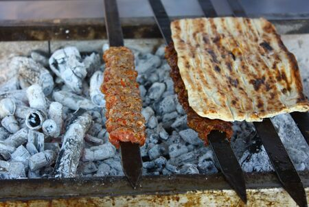 Turkish famous food called kebab was preparing on barbecue  photo