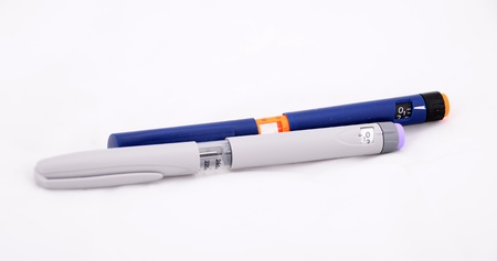 Two insulin pens were shot on white background  Stock Photo