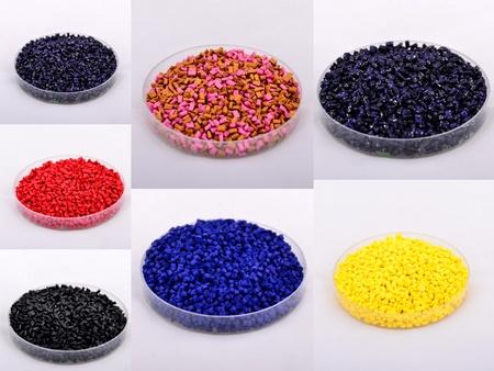 Colored polymer granules were shot in plastic cap  photo