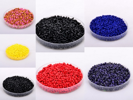 Colored polymer granules were shot in plastic cap  Stock Photo
