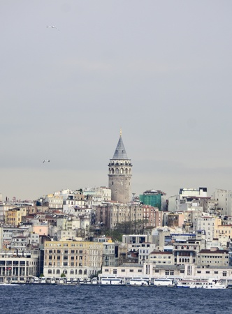 Galata Tower is another symbol of old Istanbul, shot from boat which was on the sea