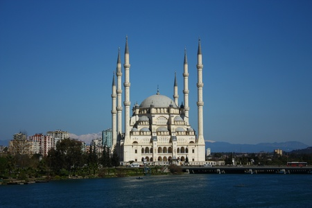 Six minarets of mosque in Adana, with viewof river  Stock Photo