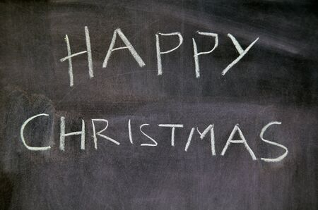 Happy christmas message is on blackboard