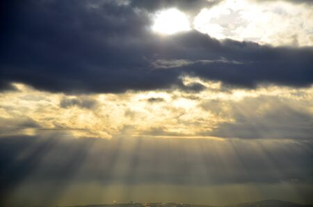 Sun lights pass among the clouds like holy light  Stock Photo