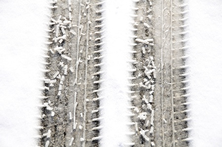 Tracks of car tires on snow. Stock Photo - 19938276