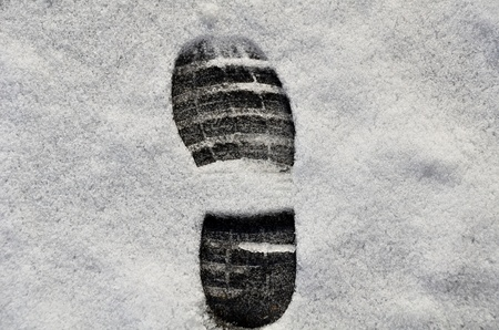Boot print placed on new snow Stock Photo - 20458259