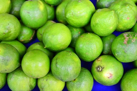 Green colored fruits are on grocery shelf. Stock Photo