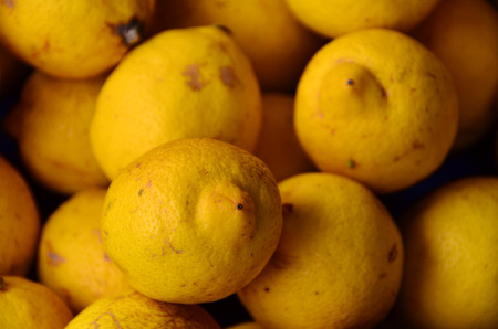 Yellow colored fruits are on grocery shelf. Stock Photo