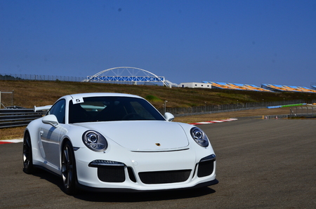 Istanbul, Turkey-July 30, 2015: Very fast white sports car parked on race track short-cut area.That has ready for track race on July 30, 2015 in Istanbul, Turkey speedway. Editorial