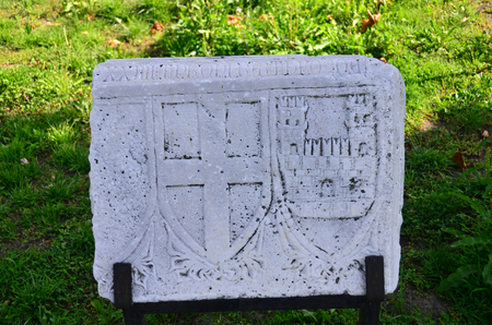 Cross and castle symbols are on ancient stone. Editorial