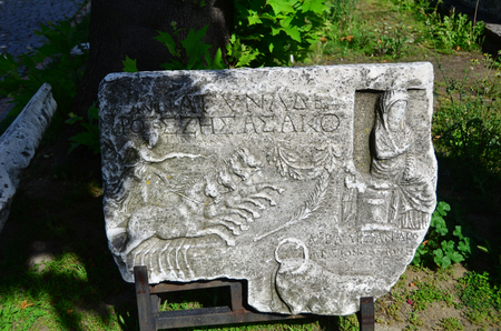 Ancient scripts are on old marble stone, in Greek.