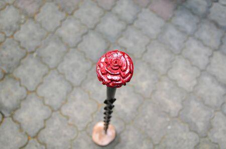 Decorative rose shape pommel made of wood.
