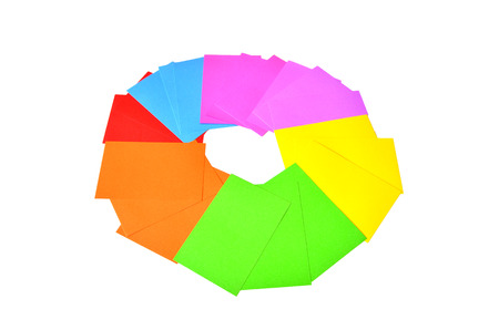 Colorful note papers are on white, makes cirle.