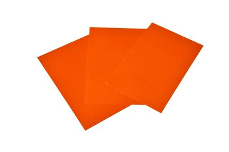 Orange colored note papers are on white.