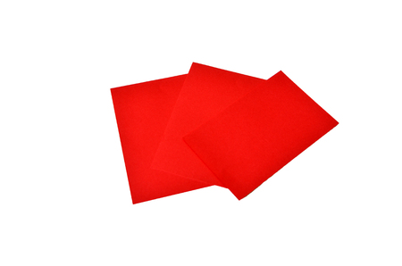 Red colored note papers shot on white background.