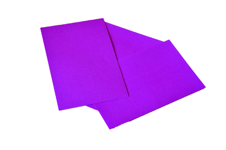 Purple colored note papers shot on white background. Stock Photo