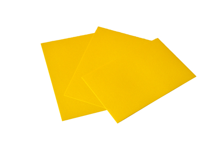 Yellow note papers shot on white background.