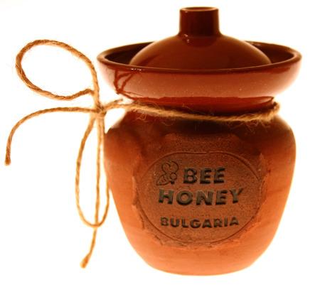 Traditional ceramic jar especially for honey, shot alone.