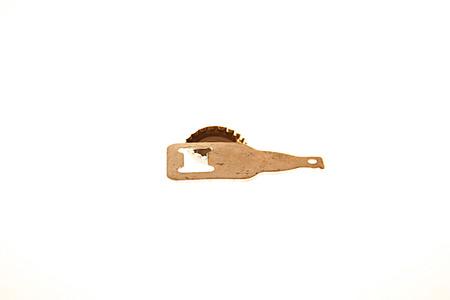 Bottle cap and metal bottle opener shot together. Banco de Imagens