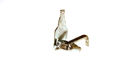 Pipe clip, screw and metal bottle opener shot together. Stock Photo