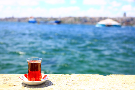 It is leisure time next to Istanbul Bosphorus watching sea and drinking traditional Turkish tea.