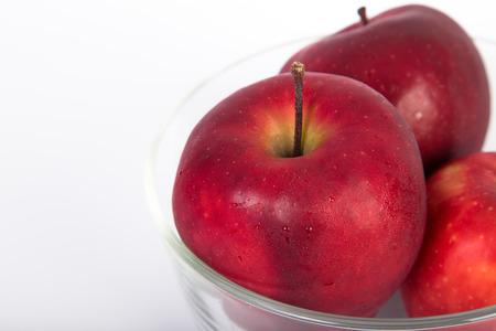 flesh colour: Fresh apple in clear bowl