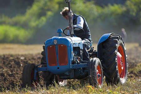 ploughing field: Agricultural Tractor ploughing a field